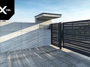 Black Heron. Nowoczesne ogrodzenie z betonu architektonicznego i aluminium