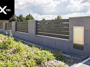 Concretely Black. Nowoczesne ogrodzenie z aluminium i betonu architektonicznego