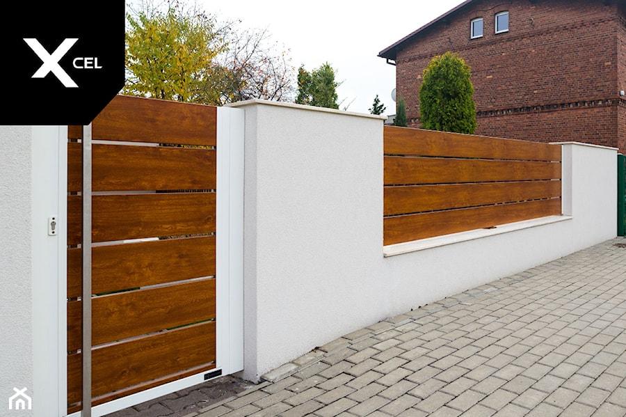 Aranżacje wnętrz - Ogród: Aluminiowe ogrodzenie Horizon Massive - XCEL Ogrodzenia. Przeglądaj, dodawaj i zapisuj najlepsze zdjęcia, pomysły i inspiracje designerskie. W bazie mamy już prawie milion fotografii!