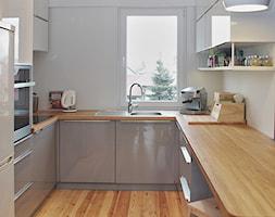 KUCHNIA I ŁAZIENKA - realizacja - Średnia zamknięta biała kuchnia w kształcie litery u, styl nowoczesny - zdjęcie od LUIZA STAR