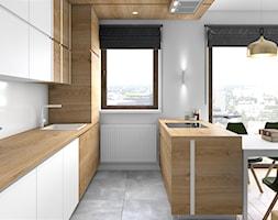 Drewno i zieleń - Średnia biała kuchnia jednorzędowa w aneksie z wyspą z oknem, styl minimalistyczny - zdjęcie od Fabryka Nastroju Izabela Szewc