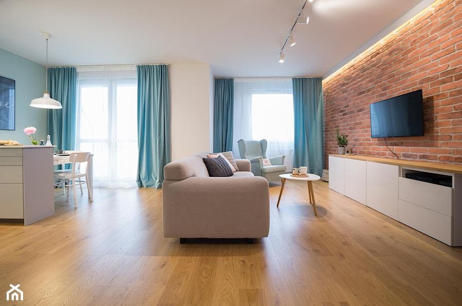 Aranżacje - Średni szary biały salon z kuchnią z jadalnią z tarasem / balkonem, styl skandynawski - zdjęcie od Elkamino Dom