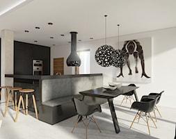Przestrzeń która nie boi się czerni - Średnia otwarta biała kuchnia w kształcie litery g w aneksie z oknem, styl minimalistyczny - zdjęcie od Creoline