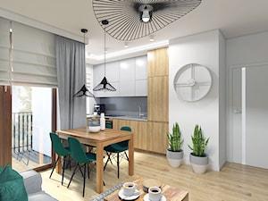 Barwy ziemi - Mała otwarta wąska szara kuchnia w kształcie litery l w aneksie z oknem, styl nowoczesny - zdjęcie od Creoline
