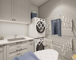 Jasnoszara pralnia ze składanymi suszarkami - zdjęcie od Studio Projektowe Atoato - Homebook