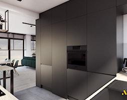 Zabudowa+kuchenna+z+ukrytymi+drzwiami+do+spi%C5%BCarni+-+zdj%C4%99cie+od+Studio+Projektowe+Atoato