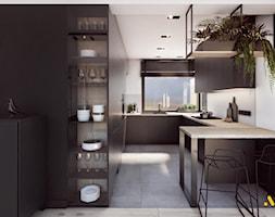 Kuchnia+antracytowa+z+elementami+drewna+-+zdj%C4%99cie+od+Studio+Projektowe+Atoato