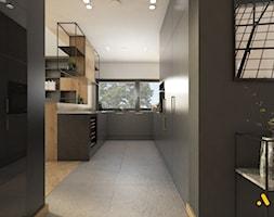kuchnia+z+szarymi+meblami+-+zdj%C4%99cie+od+Studio+Projektowe+Atoato