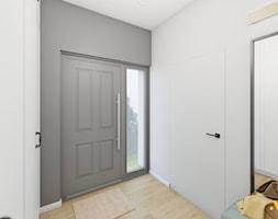 Przedpokój z dużym lustrem - zdjęcie od Studio Projektowe Atoato - Homebook