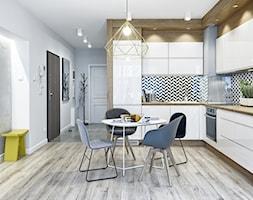 Mieszkanie pokazowe - Średnia otwarta biała kuchnia w kształcie litery l, styl skandynawski - zdjęcie od Q2Design