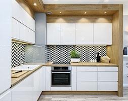 Mieszkanie pokazowe - Średnia biała kolorowa kuchnia w kształcie litery l w aneksie, styl skandynawski - zdjęcie od Q2Design