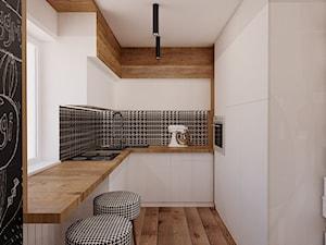 Mieszkanie 65m2 - Mała otwarta wąska biała czarna kolorowa kuchnia w kształcie litery u, styl skandynawski - zdjęcie od Ale design Grzegorz Grzywacz