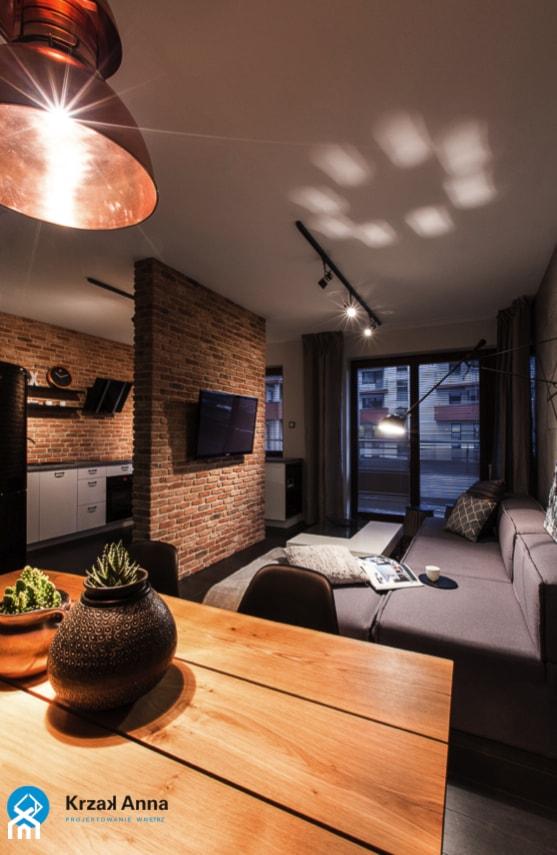 mieszkanie kawalera - Mały szary beżowy salon z kuchnią z jadalnią, styl nowoczesny - zdjęcie od Anna Krzak architektura wnętrz