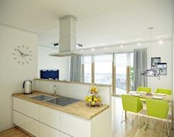 KOMFORT MIEJSKIEGO ŻYCIA - TUMSKA APARTMENTS - Mała średnia otwarta kuchnia jednorzędowa z wyspą, styl nowoczesny - zdjęcie od PRACOWNIE WNĘTRZ KODO