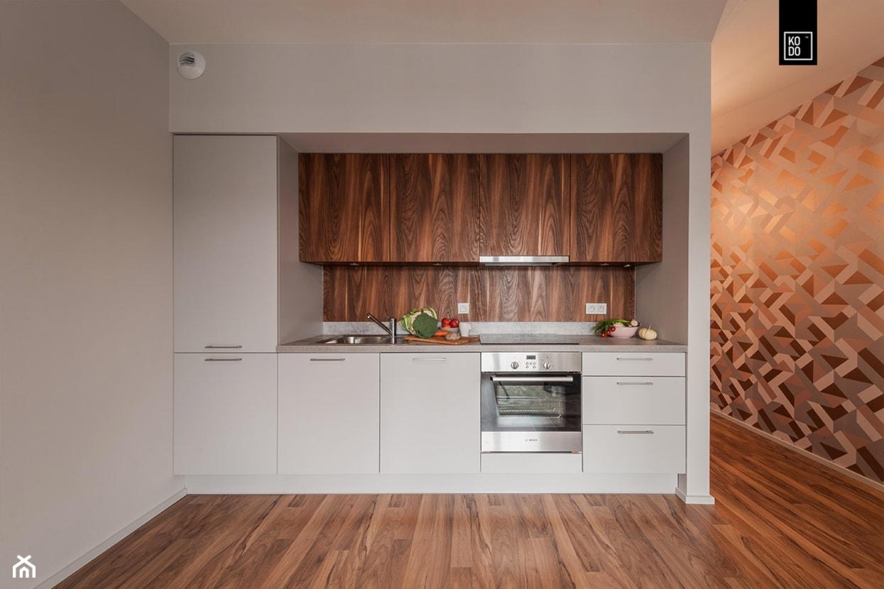 MĘSKI RÓŻ - Mała otwarta biała kuchnia jednorzędowa, styl minimalistyczny - zdjęcie od KODO projekty i realizacje wnętrz - Homebook