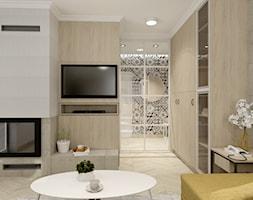 Świetliste mieszkanie z nutką energii - Średni biały salon z barkiem, styl skandynawski - zdjęcie od Bubbles Studio - Homebook
