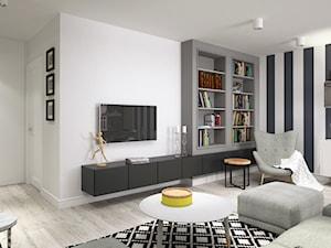BIAŁYSZARYCZARNY - Duży biały salon z bibiloteczką, styl skandynawski - zdjęcie od DOMagała Design