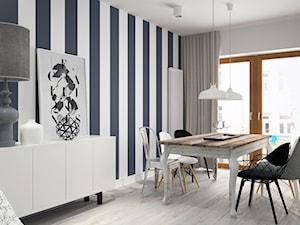 BIAŁYSZARYCZARNY - Średnia otwarta biała szara jadalnia w salonie, styl skandynawski - zdjęcie od DOMagała Design