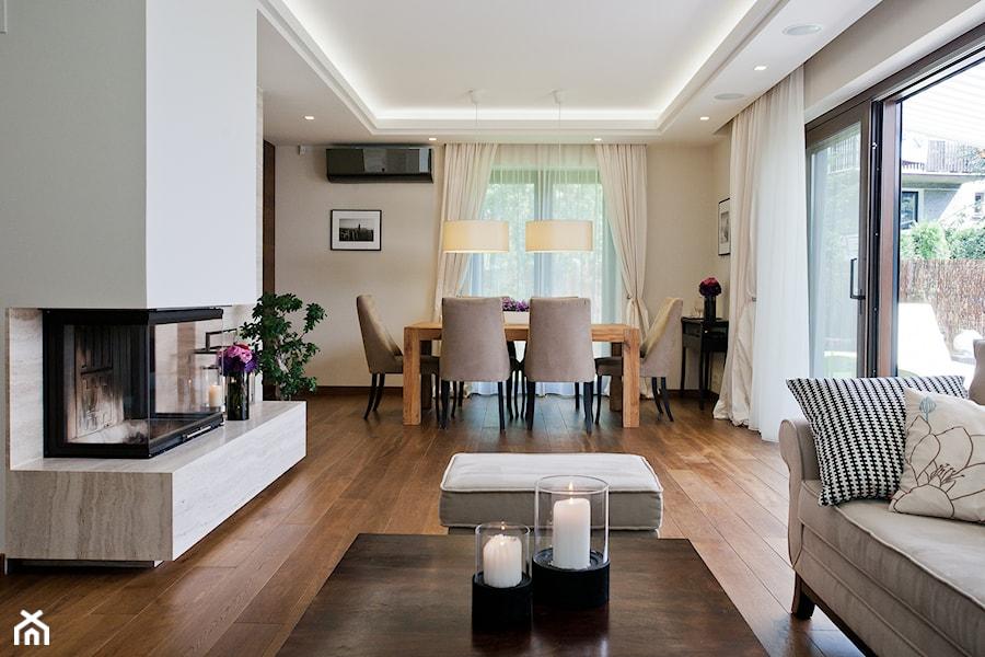 Dom w Krakowie - realizacja - Średni salon z jadalnią, styl nowoczesny - zdjęcie od ARCHISSIMA