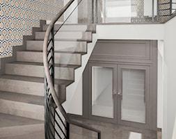 Projekt wnętrz domu - Duże szerokie schody zabiegowe z materiałów mieszanych, styl art deco - zdjęcie od ARCHISSIMA
