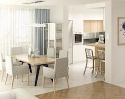 Średnia otwarta beżowa jadalnia w kuchni, styl minimalistyczny - zdjęcie od APkwadrat