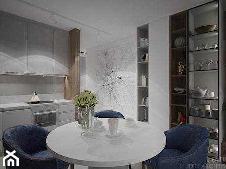 Aranżacje wnętrz - Jadalnia: Mieszkanie w Warszawie - Mała otwarta biała jadalnia w kuchni, styl nowoczesny - mgr sztuki arch. wnętrz Ewelina Matysiak. Przeglądaj, dodawaj i zapisuj najlepsze zdjęcia, pomysły i inspiracje designerskie. W bazie mamy już prawie milion fotografii!