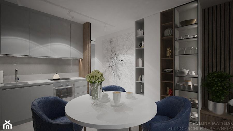 Mieszkanie w Warszawie - Mała otwarta biała jadalnia w kuchni, styl nowoczesny - zdjęcie od Ewelina Matysiak