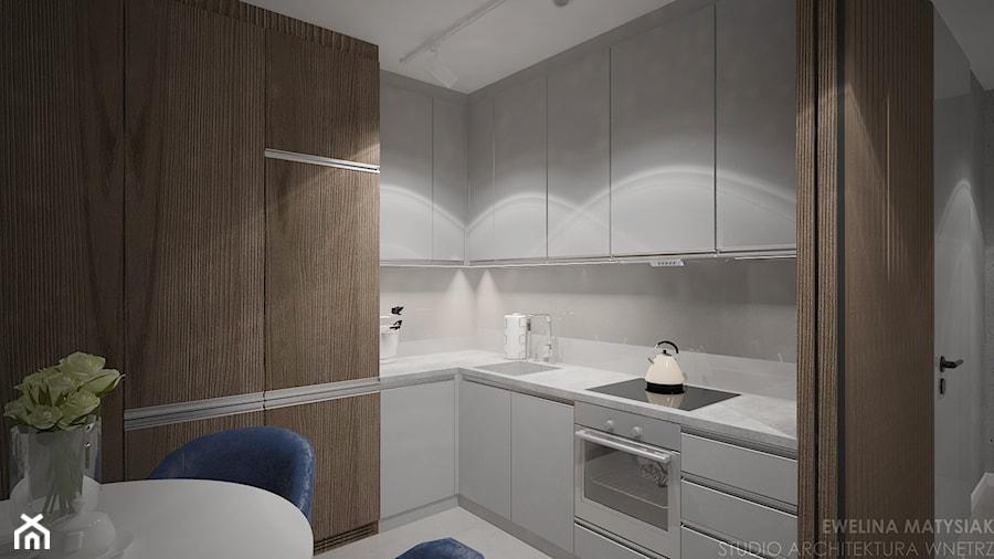 Mieszkanie w Warszawie - Średnia biała kuchnia w kształcie litery l w aneksie, styl nowoczesny - zdjęcie od Ewelina Matysiak