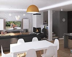 Wnętrze domu w zabudowie szeregowej - Ruda Śląska - Średni szary biały czarny salon z bibiloteczką z ... - zdjęcie od RESE Architekci Studio Projektowe - Homebook