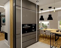 Metal z ciepłym dębem - Średnia otwarta szara czarna kuchnia w kształcie litery l z oknem, styl skandynawski - zdjęcie od ARCHITETTO