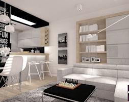 50 m.kw z dodatkiem szarości - Mała otwarta biała czarna jadalnia w kuchni w salonie, styl minimalistyczny - zdjęcie od ARCHITETTO
