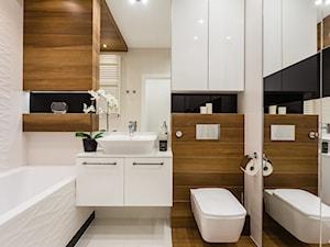 Łazienka z drewnem - Średnia beżowa łazienka w bloku w domu jednorodzinnym bez okna, styl nowoczesny - zdjęcie od ARCHITETTO