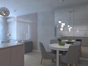 Monochromatyczna aranżacja wnętrza w kolorze szarym - Mała otwarta biała jadalnia w kuchni, styl minimalistyczny - zdjęcie od LIVING BOX