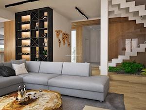 Dom z kominkiem w roli głównej - Średni duży salon z barkiem, styl nowoczesny - zdjęcie od LIVING BOX