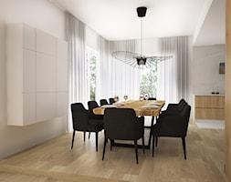 Dom z kominkiem w roli głównej - Duża otwarta biała jadalnia jako osobne pomieszczenie, styl nowoczesny - zdjęcie od LIVING BOX