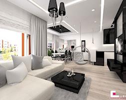 Mieszkanie w Trójmieście - Duży biały czarny salon z jadalnią, styl glamour - zdjęcie od CUBE Interior Design