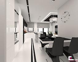 Mieszkanie 65 m2 w Warszawie - Mała otwarta biała jadalnia jako osobne pomieszczenie, styl nowoczesny - zdjęcie od CUBE Interior Design