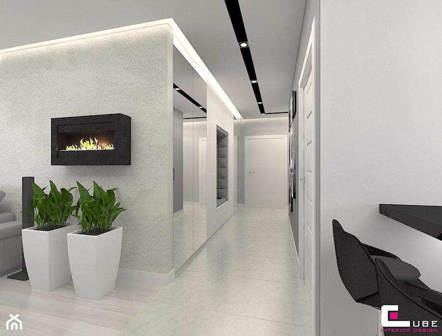 Mieszkanie 70 m2 w Warszawie - Mały biały szary hol / przedpokój, styl nowoczesny - zdjęcie od CUBE Interior Design