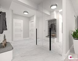 Projekt mieszkania w Siedlcach - Duży biały hol / przedpokój, styl nowoczesny - zdjęcie od CUBE Interior Design