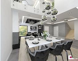 DOM W KOBYŁCE - Duża otwarta biała jadalnia w salonie, styl nowoczesny - zdjęcie od CUBE Interior Design