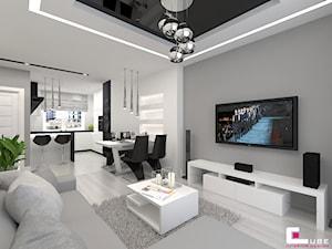 Mieszkanie 70 m2 w Warszawie - Mały szary biały salon z kuchnią z jadalnią, styl nowoczesny - zdjęcie od CUBE Interior Design