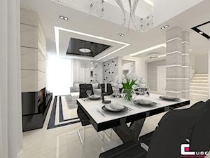 Projekt wnętrz domu - Średnia otwarta jadalnia w salonie, styl nowoczesny - zdjęcie od CUBE Interior Design