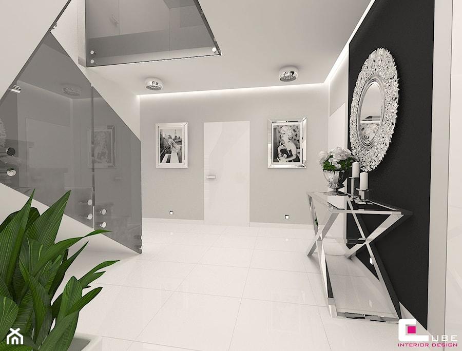 Aranżacje wnętrz - Hol / Przedpokój: DOM POD LEGNICĄ - Średni biały czarny szary hol / przedpokój, styl glamour - CUBE Interior Design. Przeglądaj, dodawaj i zapisuj najlepsze zdjęcia, pomysły i inspiracje designerskie. W bazie mamy już prawie milion fotografii!