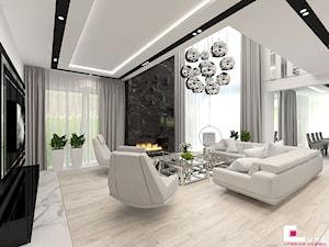 Projekt wnętrz domu w Wołominie - Duży szary biały salon z jadalnią, styl glamour - zdjęcie od CUBE Interior Design