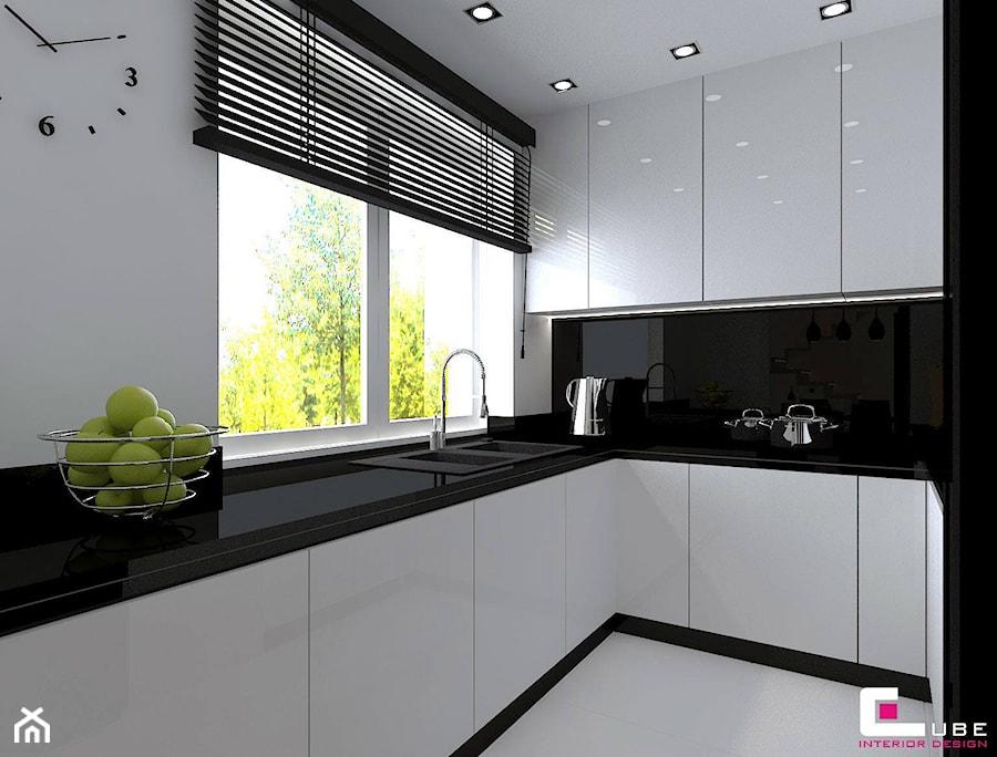 Dom w Lipkowie - Średnia biała czarna kuchnia w kształcie litery u, styl nowoczesny - zdjęcie od CUBE Interior Design