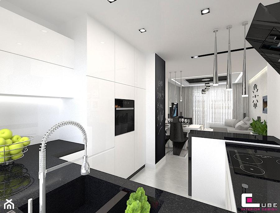 Mieszkanie 70 m2 w Warszawie - Średnia otwarta biała kuchnia w kształcie litery g w aneksie z oknem, styl nowoczesny - zdjęcie od CUBE Interior Design