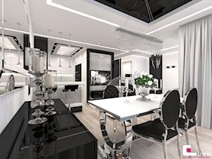 Mieszkanie w Trójmieście - Duża otwarta biała czarna jadalnia w kuchni, styl glamour - zdjęcie od CUBE Interior Design