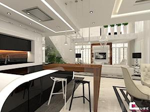DOM Z ANTRESOLĄ - Duża otwarta kuchnia dwurzędowa w aneksie z wyspą z oknem, styl art deco - zdjęcie od CUBE Interior Design