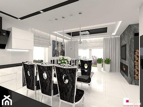 Aranżacje wnętrz - Kuchnia: DOM POD LEGNICĄ - Duża otwarta biała kuchnia w kształcie litery l w aneksie z oknem, styl glamour - CUBE Interior Design. Przeglądaj, dodawaj i zapisuj najlepsze zdjęcia, pomysły i inspiracje designerskie. W bazie mamy już prawie milion fotografii!
