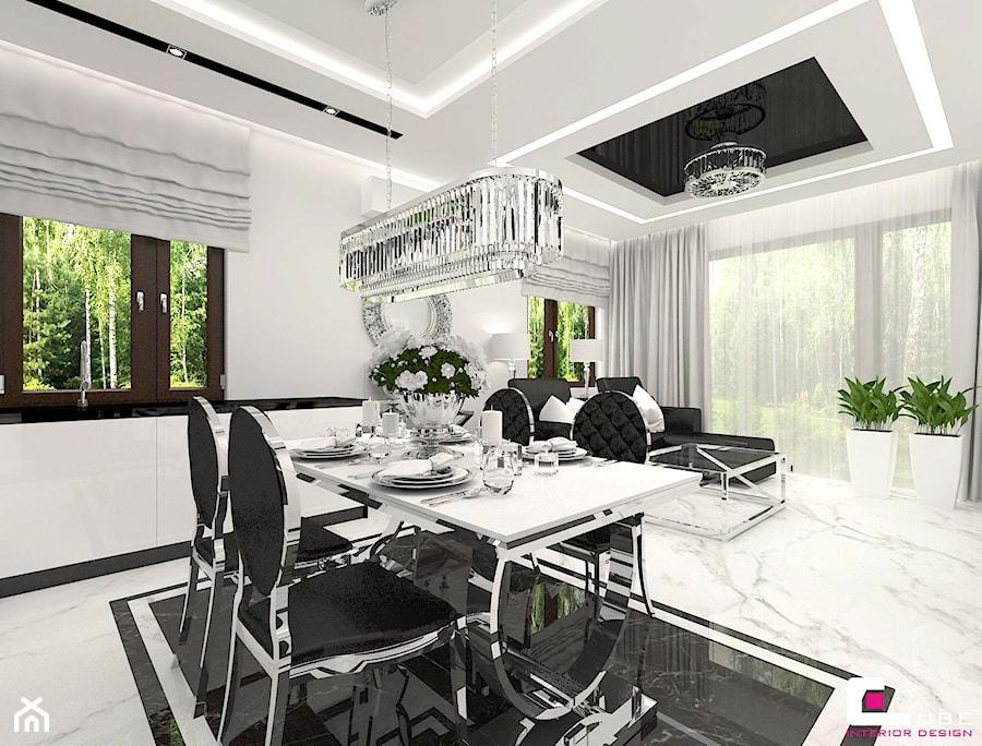 Mieszkanie pokazowe w Konstancinie-Jeziornie - Duża otwarta biała jadalnia w salonie, styl glamour - zdjęcie od CUBE Interior Design